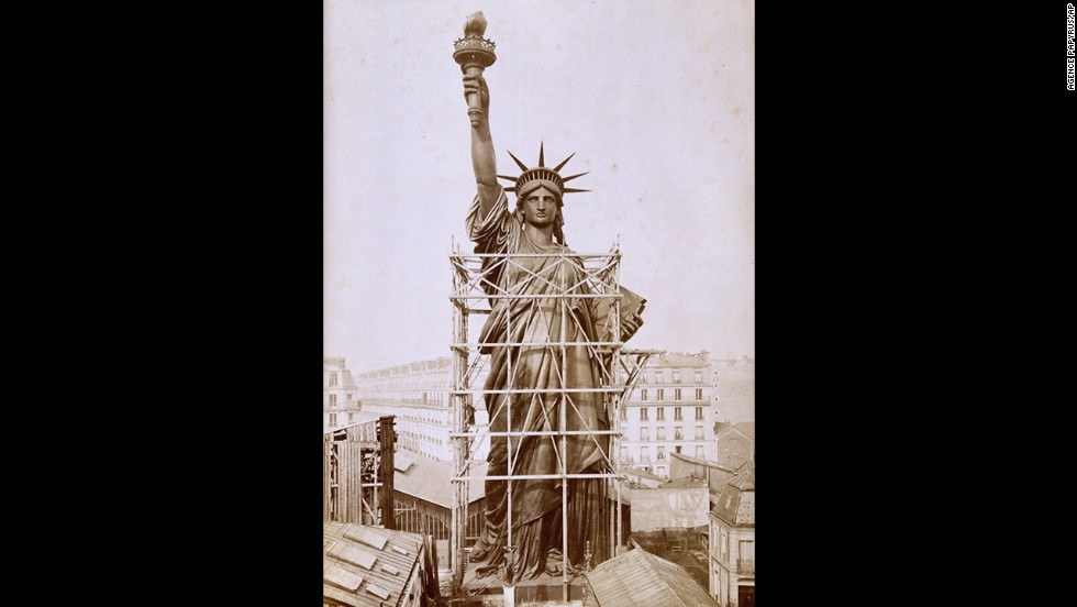 The statue, designed by sculptor Frederic Auguste Bartholdi, towers over Paris rooftops during construction in 1884. It was a gift from the people of France to commemorate 100 years of Franco-American friendship as well as the centennial of America's independence.