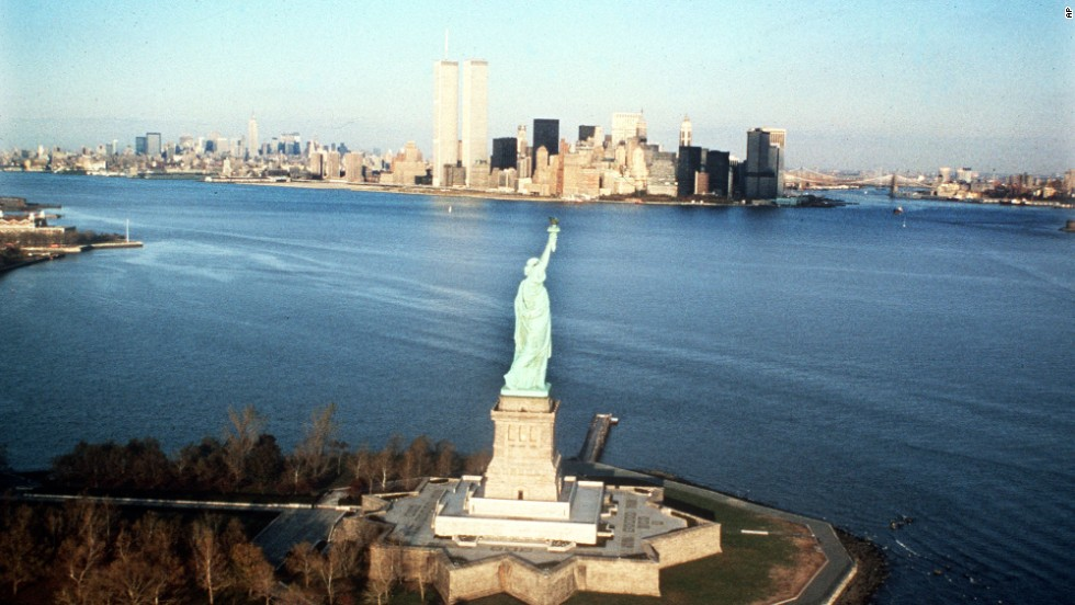 The New York Harbor and the World Trade Center building are seen behind the statue in 1980.