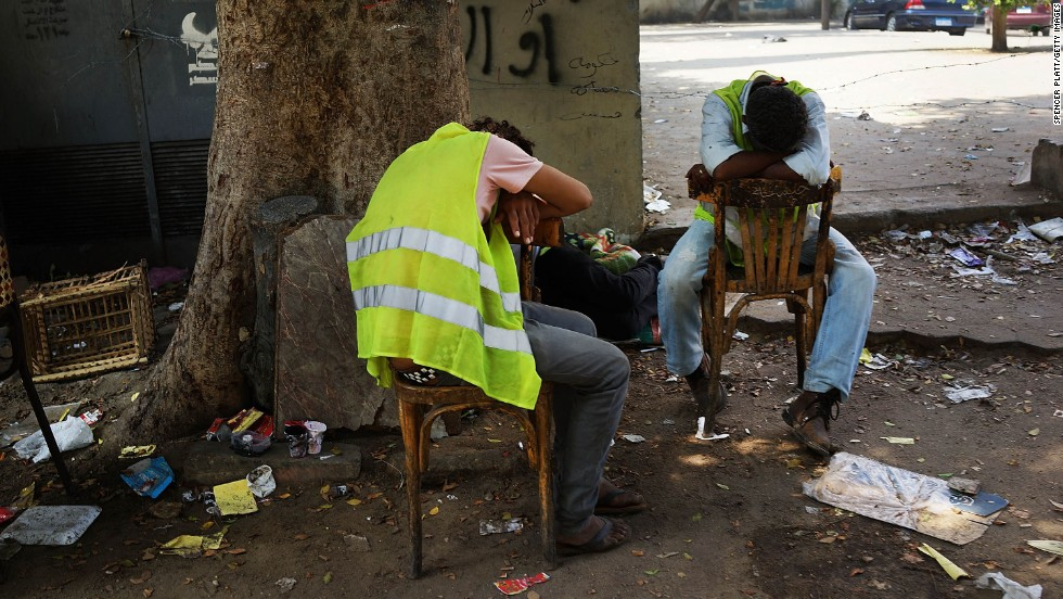 Security personnel rest on July 4 in Tahrir Square.