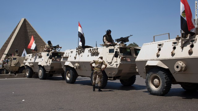 Armoured vehicles with the Egyptian army sit at a checkpoint in the Cairo district of Nasser City on July 4.