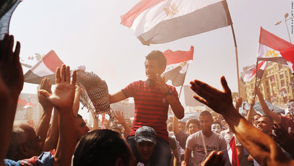 People dance and cheer at Tahrir Square in Cairo on July 4.