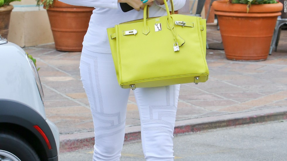 Khloe Kardashian keeps her bright bag front and center in Malibu on July 3.