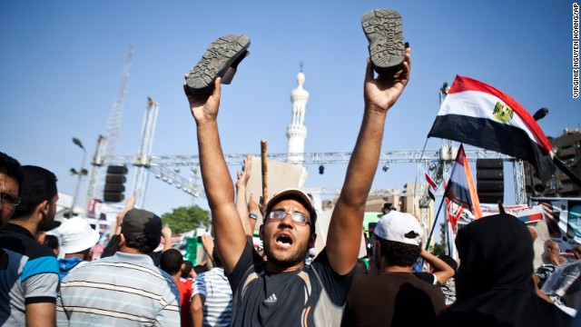 A supporter of ousted Egyptian President Mohamed Morsy reacts as an military helicopter flies over during a rally in Nasr City, Cairo, on July 4.