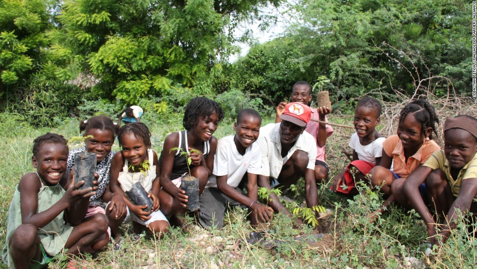 Children of the Smallholder Farmers Alliance members plant trees to help combat the extreme deforestation in Haiti