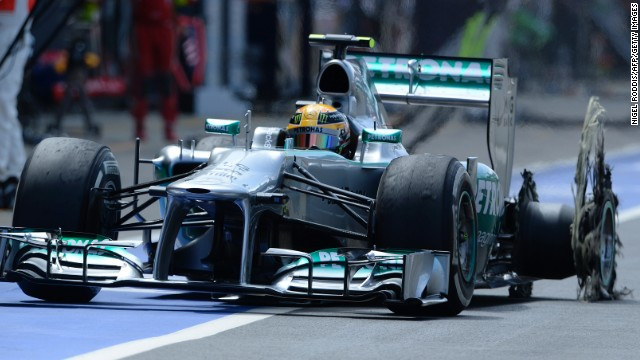 Lewis Hamilton pits with a shredded left rear tire after his high speed blow out at Silverstone in the British GP.