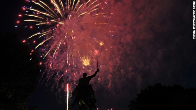 Fireworks light up the statue of Simon Bolivar during Independence Day celebrations on July 4, 2013 in Washington, DC. Independence Day celebrates the US declaring independence from Britain in 1776. AFP PHOTO/Mandel NGAN (Photo credit should read MANDEL NGAN/AFP/Getty Images)