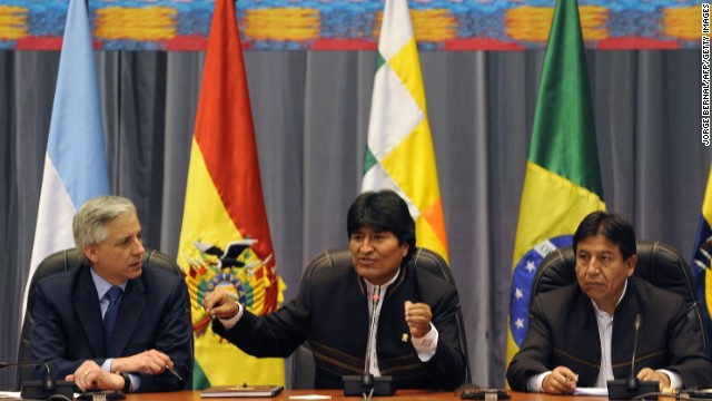 Bolivia's President Evo Morales (C), flanked by Vice-President Alvaro Garcia Linera (L) and Foreign Minister David Choquehuanca, opens a meeting with other leftist Latin American leaders called after his plane was rerouted amid suspicions US fugitive Edward Snowden was aboard, in the Bolivian central city of Cochabamba, on July 4, 2013. Leftist Latin American leaders gathered in Cochabamba on Thursday to back President Evo Morales, fuming after some European nations temporarily refused his plane access to their airspace amid suspicions US fugitive Edward Snowden was aboard. Snowden is seeking sanctuary in several nations to evade US espionage charges.