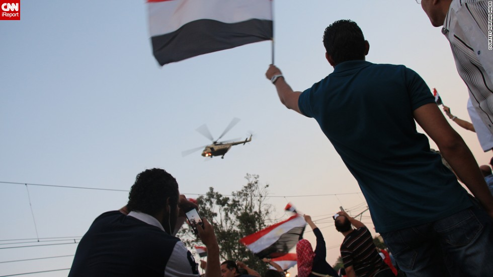 "<a href=""http://ireport.cnn.com/docs/DOC-999917"">Norman Halim</a> also captured this striking image earlier July 3 of an army helicopter hovering over the crowd."