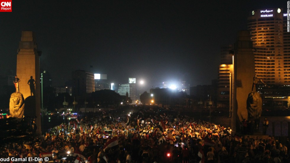 "iReporter <a href=""http://ireport.cnn.com/docs/DOC-999679"">Mahmoud Gamal</a> captured this image of crowds in Cairo on Wednesday, July 3, after news came Mohamed Morsy, the former Egyptian president, had been ousted. ""It was an amazing carnival,"" he said."
