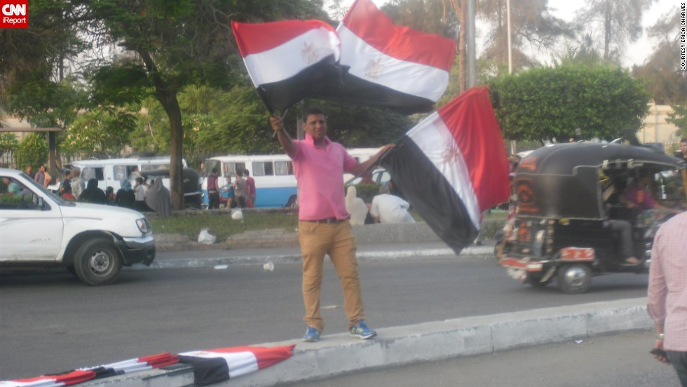 "Freelance journalist <a href=""http://ireport.cnn.com/docs/DOC-999156"">Erica Charves</a> captured this street scene July 2 as protests against Morsy gathered momentum."