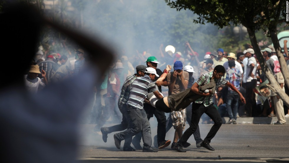 Morsy supporters carry a man who was shot during clashes next to the Republican Guard headquarters in Cairo on July 5. State broadcaster Nile TV said a number of those backing the deposed leader were wounded as they tried to storm the headquarters, where Morsy reportedly was being held.