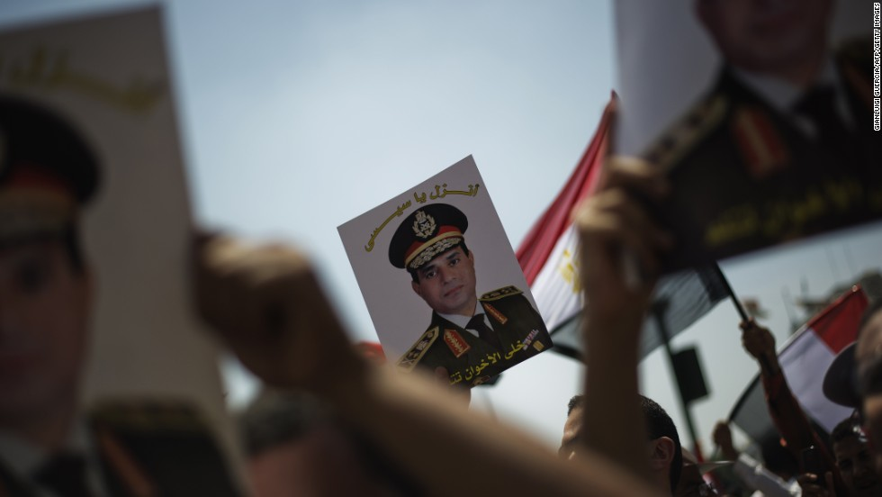 "Egyptians hold portraits of Gen. Abdel-Fatah El-Sisi reading ""Come down, Sisi"" as they gather in Cairo's landmark Tahrir Square on July 5."
