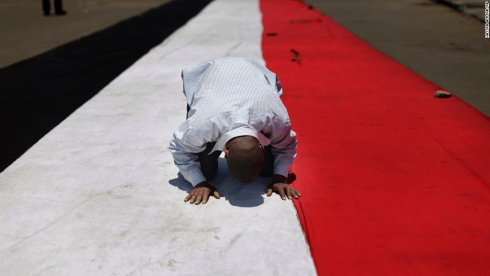 A man prays on July 5 before the protest near the University of Cairo.