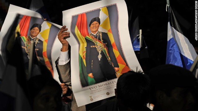 People in the crowd hold posters of Bolivia's President Evo Morales during a welcoming gathering in honour of the Bolivian leader following his arrival from Europe, in the Bolivian central city of Cochabamba, on July 4, 2013. Leftist Latin American leaders gathered in Cochabamba on Thursday to back President Evo Morales, fuming after some European nations temporarily refused his plane access to their airspace amid suspicions US fugitive Edward Snowden was aboard. Snowden is seeking sanctuary in several nations to evade US espionage charges. AFP PHOTO / JORGE BERNAL (Photo credit should read JORGE BERNAL/AFP/Getty Images)