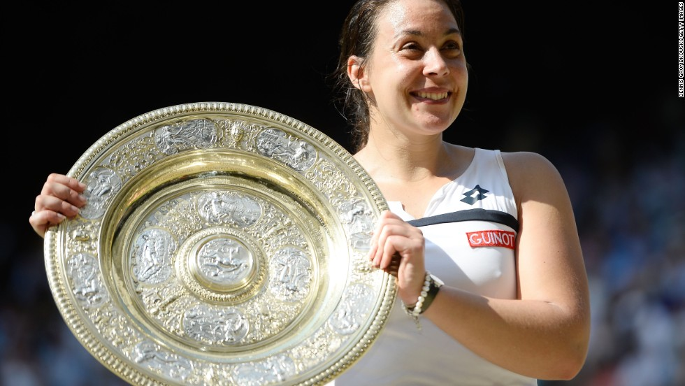 Marion Bartoli with the Venus Rosewater Dish. The 28-year-old claimed her first Grand Slam singles title with victory over Germany's Sabine Lisicki at Wimbledon on Saturday.