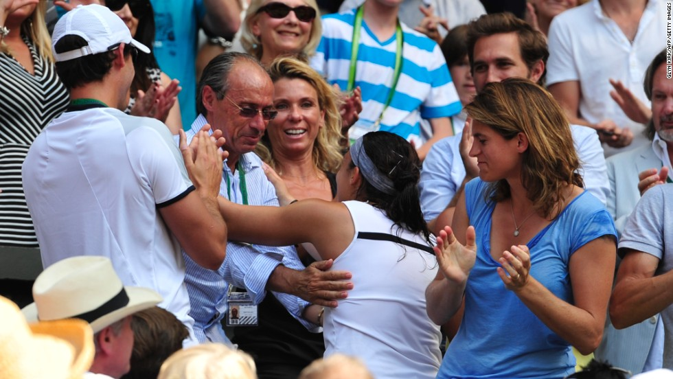 Bartoli celebrated her Wimbledon win with her father Walter, who was her coach for over 20 years before she began working with former world No. 1 Amelie Mauresmo (right).