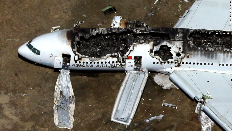 The burned-out plane remains on the runway on July 6. Passengers and crew members escaped down the emergency inflatable slides.
