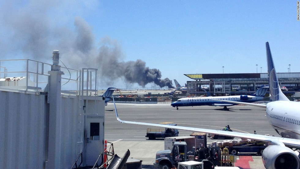 Smoke rises from the crash site on July 6 at the airport in San Francisco.