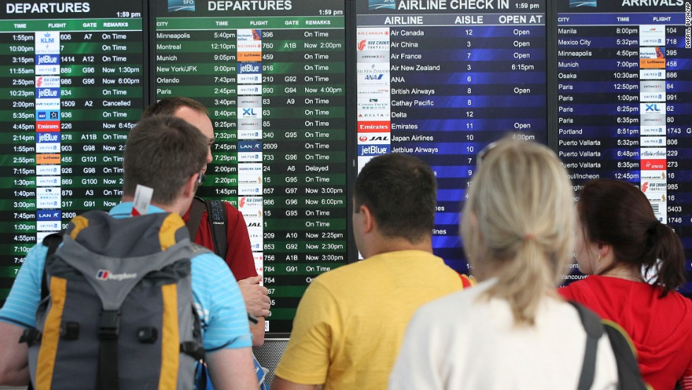 Travelers at San Francisco International Airport look at the departures and arrivals board after Asiana Flight 214 crashed on July 6. The airport, located 12 miles south of downtown San Francisco, is California's second busiest, behind Los Angeles International.