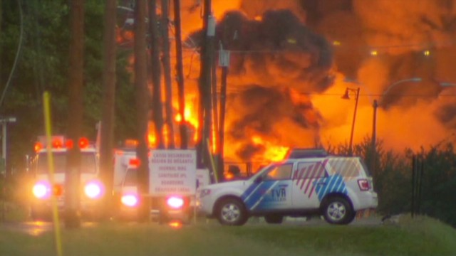 Flames erupt in deadly train derailment