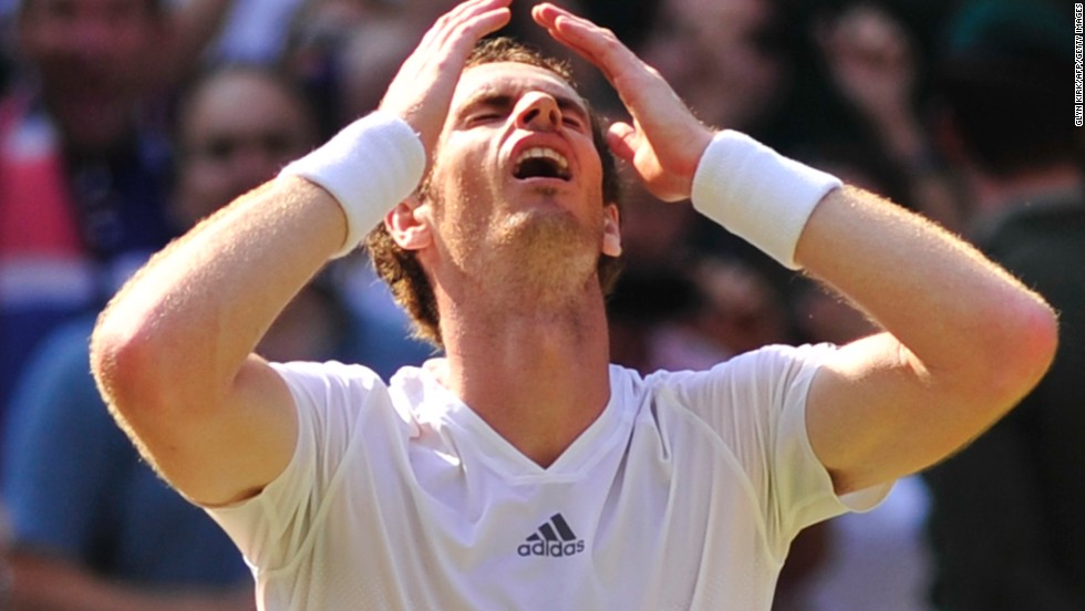 Murray celebrates after claiming the third set 6-4 to secure his first ever Wimbledon crown.