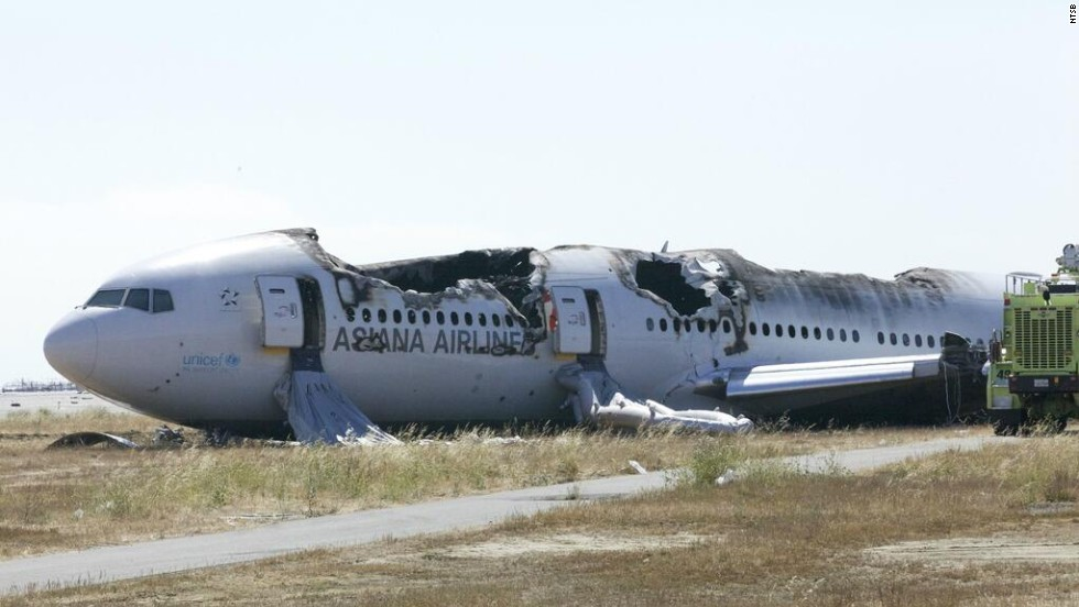 In this handout photo released by the National Transportation Safety Board, Asiana Airlines Flight 214 sits just off the runway at San Francisco International Airport on Sunday, July 7. The Boeing 777 coming from Seoul, South Korea, crashed on landing on Saturday, July 6. Three passengers, all girls, died as a result of the first notable U.S. air crash in four years.