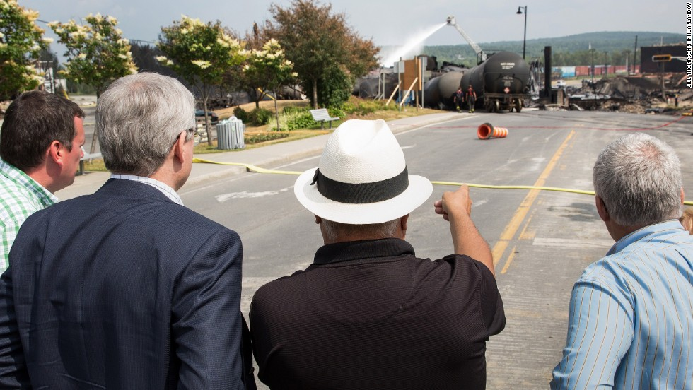 Canadian Prime Minister Stephen Harper, second left, observes the site of the explosion on Sunday, July 7.