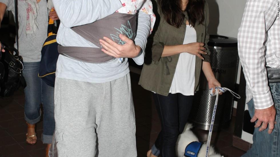 Channing Tatum and Jenna Dewan Tatum carry daughter Everly through LAX on July 7.