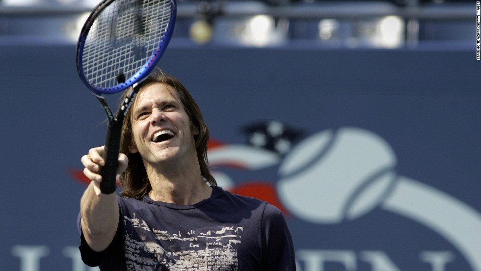 Carrey points to fans before he hits a ball into the stands during an intermission at the 2006 U.S. Open Tennis Championships in Flushing Meadows, New York.
