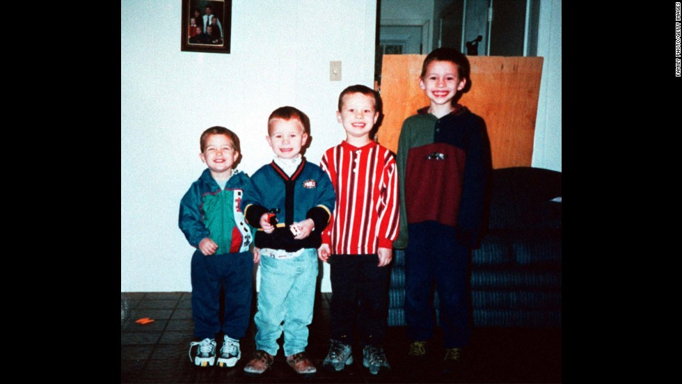 A family photo shows four of the Yates children: from left, Luke, Paul, John and Noah.