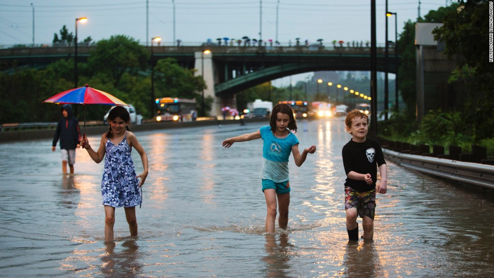 For others, the summer storm transforms the highway into an unexpected playground on July 8.