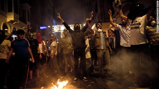 Turkish protesters shout slogans next to a bonfire during a protest on Istiklal Avenue in Istanbul on July 8, 2013.