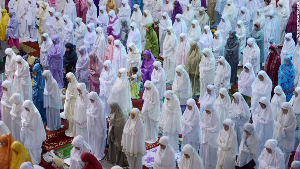 Women hold prayers on the first night of Ramadan at the Istiqlal mosque in Jakarta, Indonesia, on Tuesday, July 9.