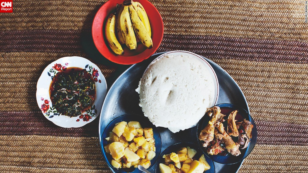 Freshly butchered chicken, sukuma wiki, boiled potatoes and plantains, and ugali.