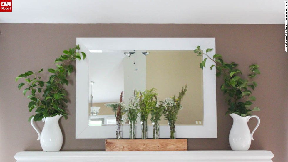 """<a href=""""http://ireport.cnn.com/docs/DOC-1001056"""">Corrie Moore</a> of Chesterfield, Michigan, created a fresh vignette on her mantle with pitchers from Target and wildflowers."""