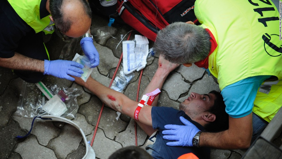 Health workers tend to an injured runner on July 9. Most injuries result from being trampled by the crowd or the bulls rather than being gored.