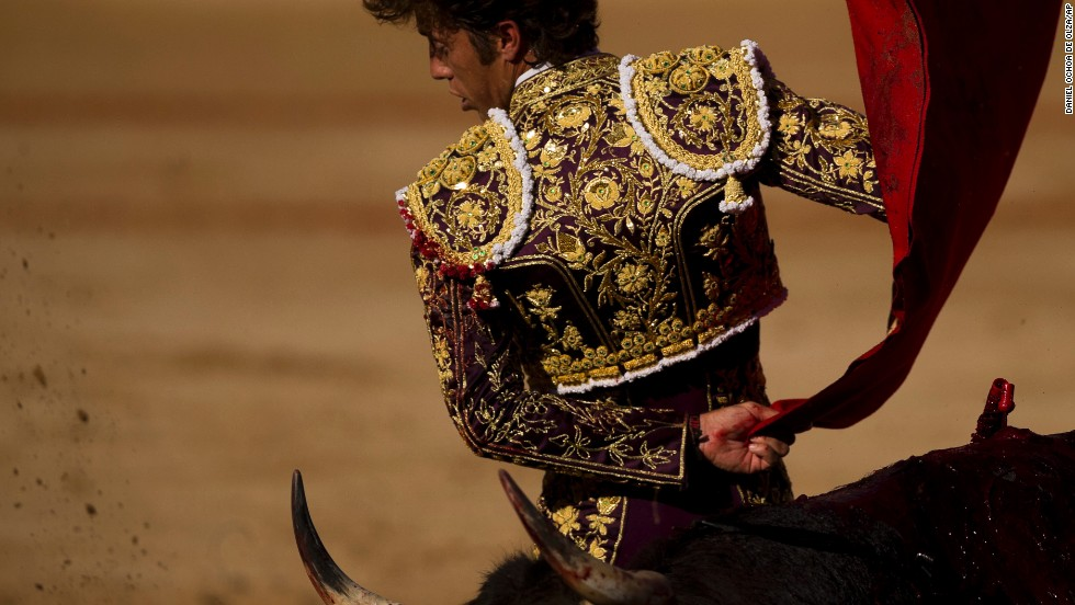Spanish matador Manuel Escribano takes on a bull during the San Fermin festival on July 8. The bulls that run through Pamplona's streets end up in the central bull ring.