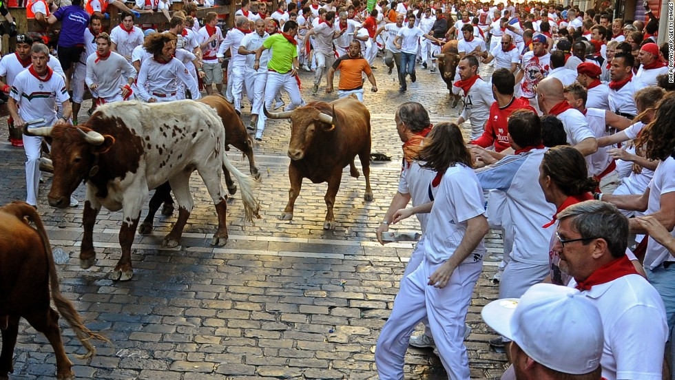 Participants run alongside bulls on Sunday, July 7. Each run lasts just a few minutes.