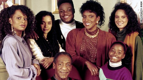 "Bill Cosby as Dr. Cliff Huxtable with his ""Cosby Show"" co-stars, from left: Tempestt Bledsoe, Lisa Bonet, Malcolm-Jamal Warner,  Phylicia Rashad, Keshia Knight Pulliam and Sabrina Le Beauf."