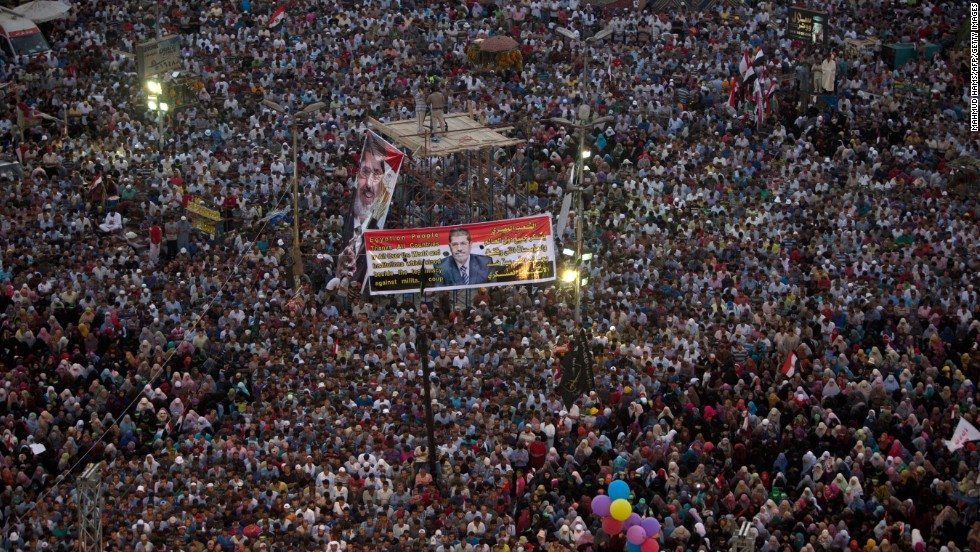 Muslim Brotherhood supporters rally in favor of Morsy outside a Cairo mosque on Sunday, July 7.