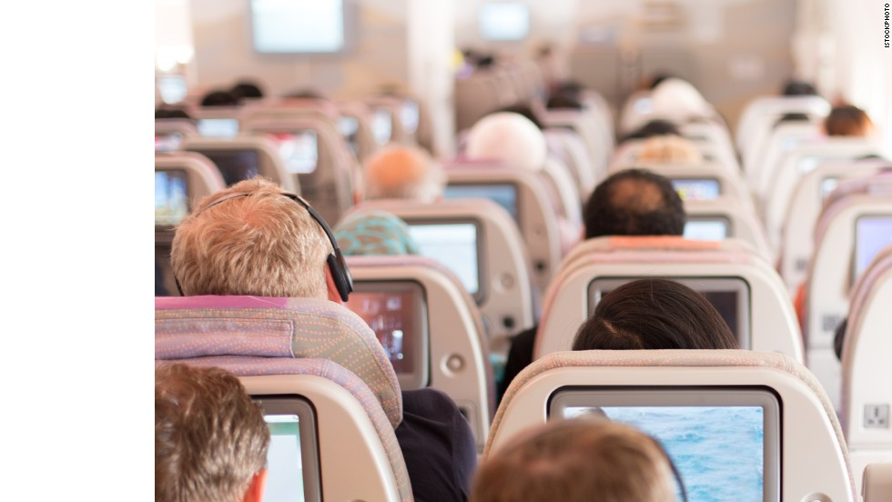 Avoid in-flight amenity fees by boarding with your own pillow, blanket, snacks and earbuds