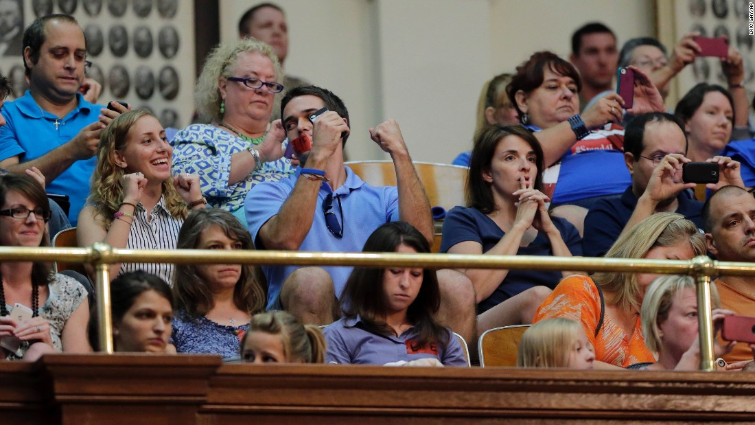 Supporters of the measure react in the gallery of the Texas House after it was provisionally approved during the second special session on July 9, 2013.