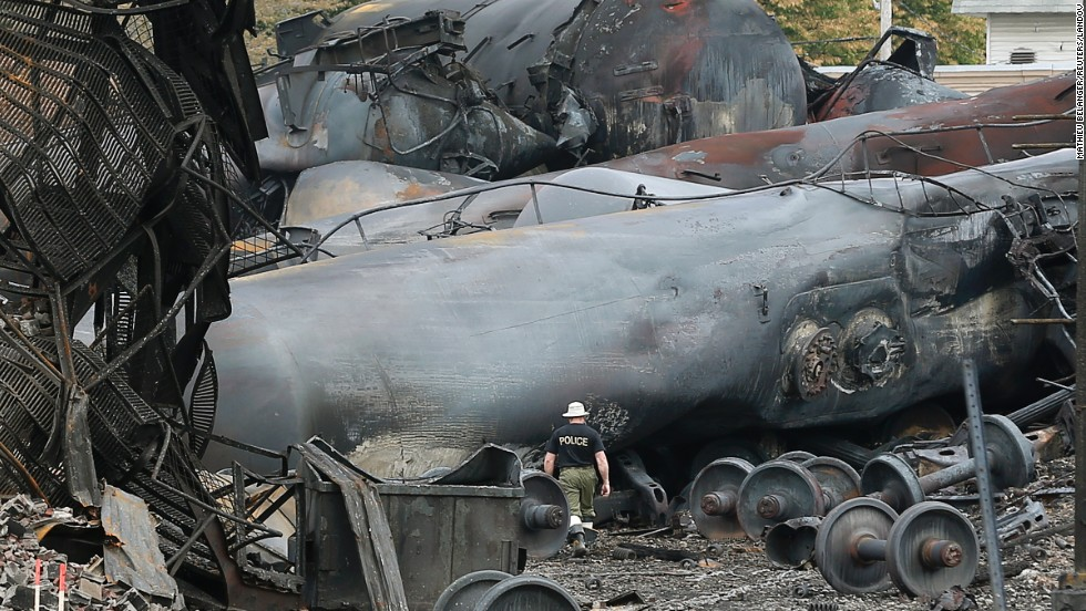 A police officer surveys the damage. At least 15 people were killed and another 45 remain missing after the weekend crash, authorities said. Those still missing are feared dead, possibly vaporized by the resulting inferno, according to some experts.