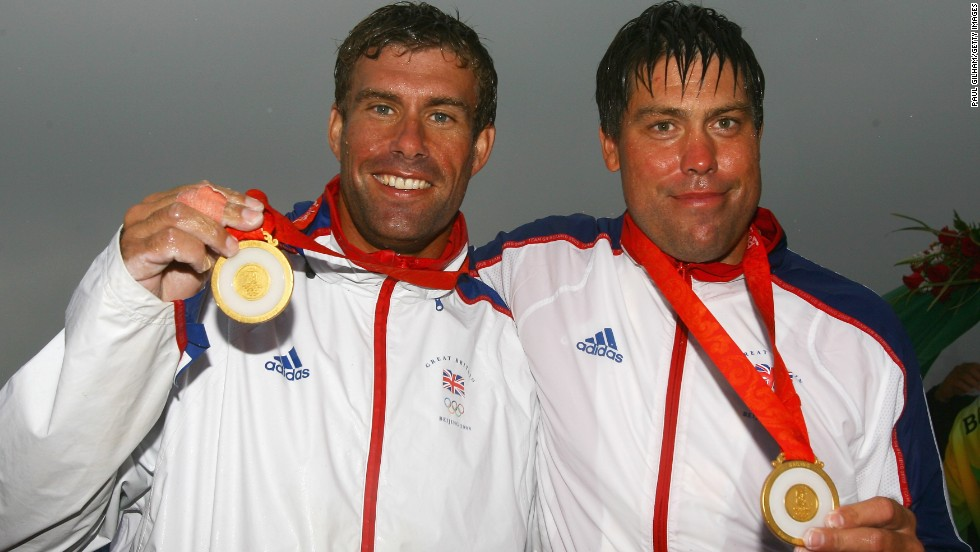 Andrew Simpson (R) receives his gold medals alongside best friend and crewmate Iain Percy at the Beijing Olympics in 2008.