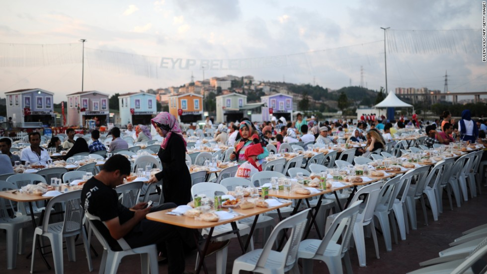 Turkish people wait to break their fast on July 10 at Eyup in Istanbul.
