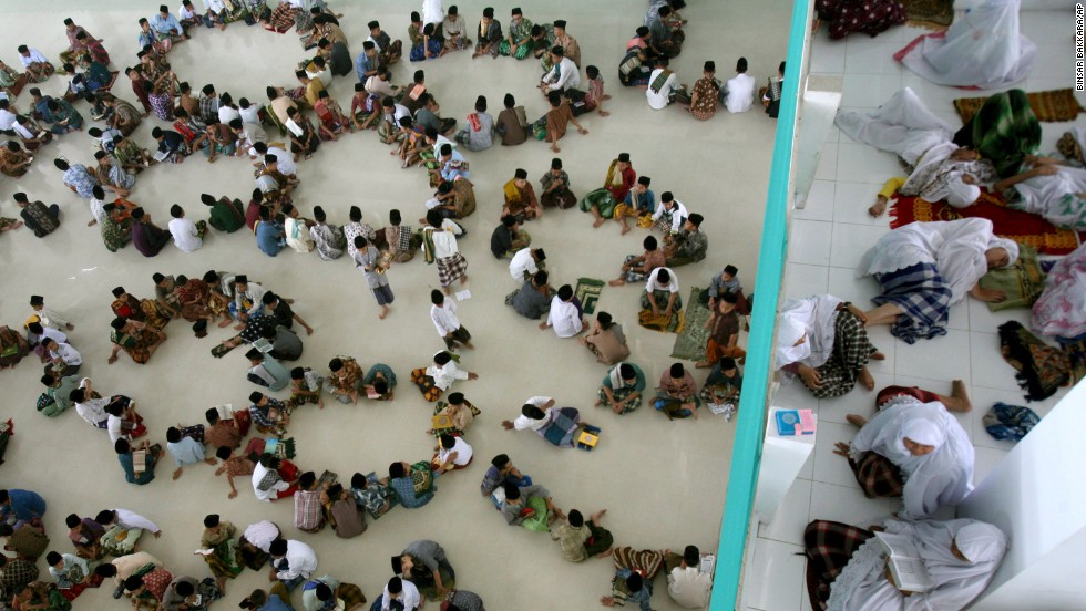 Students sit in circles during a Quran recital class in Medan on July 10.