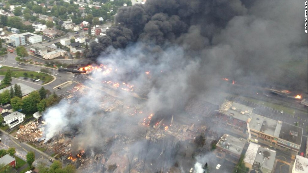 "An aerial photo from the Quebec Provincial Police shows the aftermath of a <a href=""http://www.cnn.com/2013/07/10/world/americas/canada-runaway-train/"">train derailment explosion in Lac-Megantic, Quebec</a>, on Saturday, July 6. Quebec provincial authorities have found 20 bodies, and 30 more are missing and ""most probably dead."""