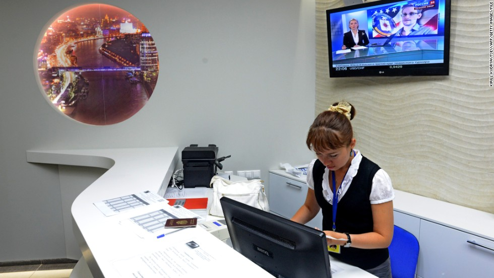 "An employee works the reception desk in the Capsule Hotel ""Air Express"" in Terminal F. Snowden has not officially entered Russia but is in the airport's transit area, the zone between arrival gates and passport control checkpoints. It includes terminals D, E and F."