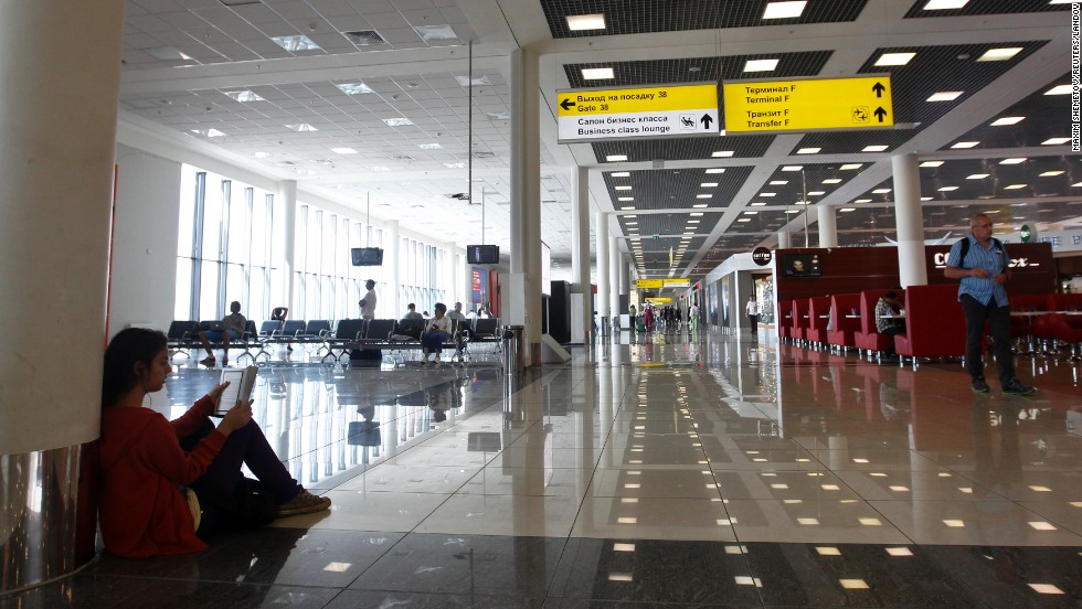 "People wait in the airport's transit area. Snowden's exact location in the <a href=""http://www.cnn.com/2013/06/26/world/europe/russia-snowden-defterios-transit"">transit lounge has remained a mystery</a>, and he cannot step foot on Russian soil without special visa clearance. Snowden said he is requesting asylum from Russia while awaiting safe passage to Latin America, according to a transcript issued by WikiLeaks.<br />"