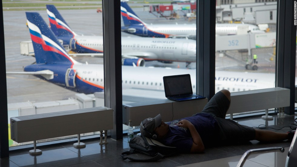 A passenger rests inside the airport on July 9.